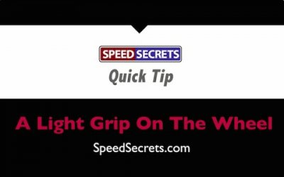 Q: How tight should my grip be on the steering wheel?